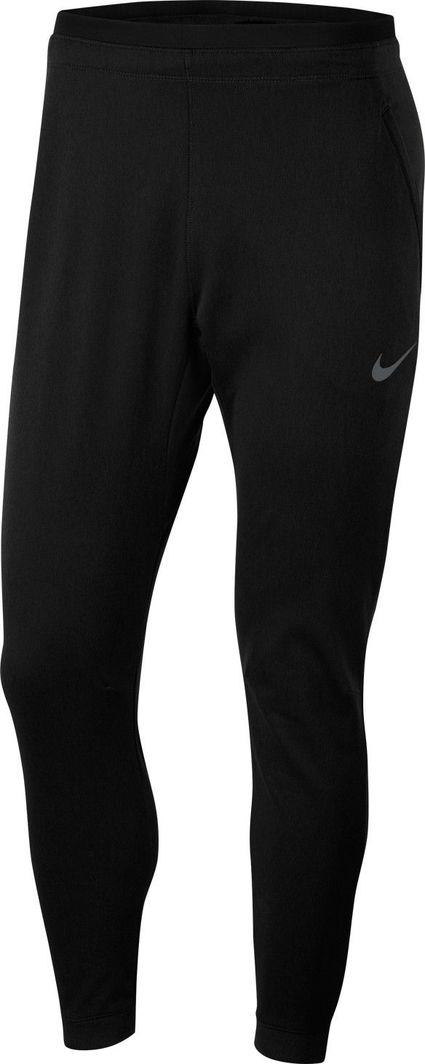 Nike Nike Pro Fleece spodnie 010 : Rozmiar - M 1