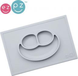 Ezpz EZPZ  Silikonowy  talerzyk  z  podkładką  2w1  Happy  Mat  pastelowa  szarość